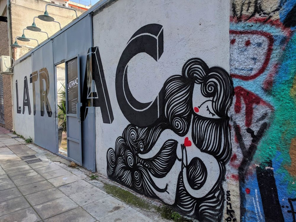 Graffiti covering the entrance of Latraac cafe-bar in Metaxourgeio.