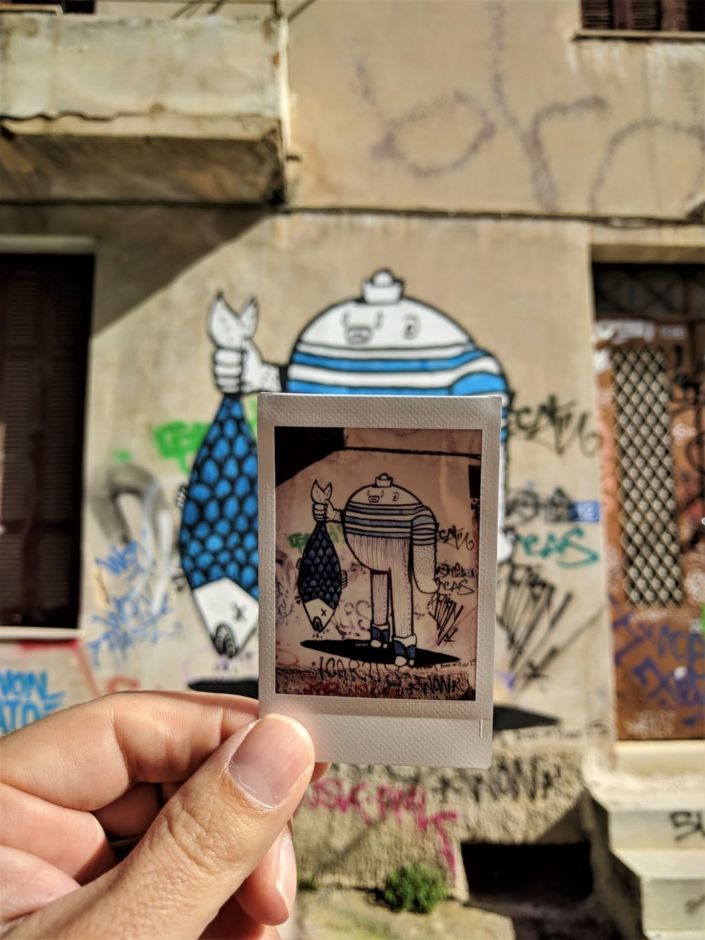 """Another cute graffiti on a polaroid image, captured in our """" Athens Instagram Photo Tour """"."""