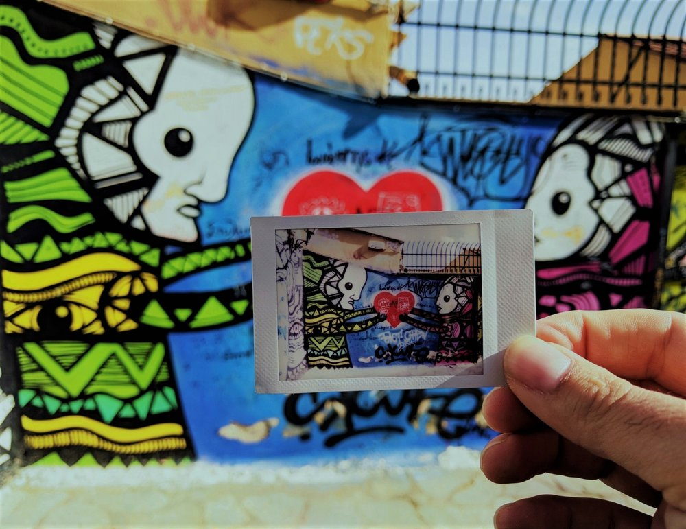 """Graffiti in Plaka as captured by our vintage camera in our original """" Athens Instagram Photo Tour """"."""