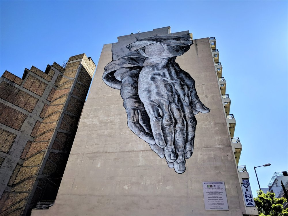 'Praying Hands' by Pavlos Tsakonas can be found on Pireaios Street in Athens.