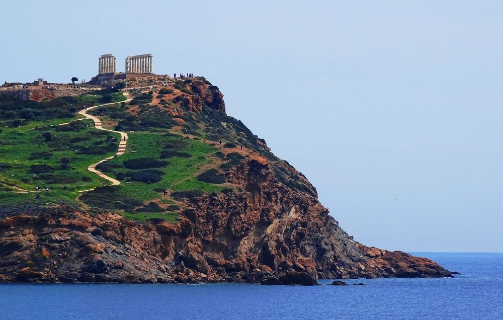 The magnificent Temple of Poseidon, as viewed from Pasalimani beach in Sounio. Source: cindyknoke.com