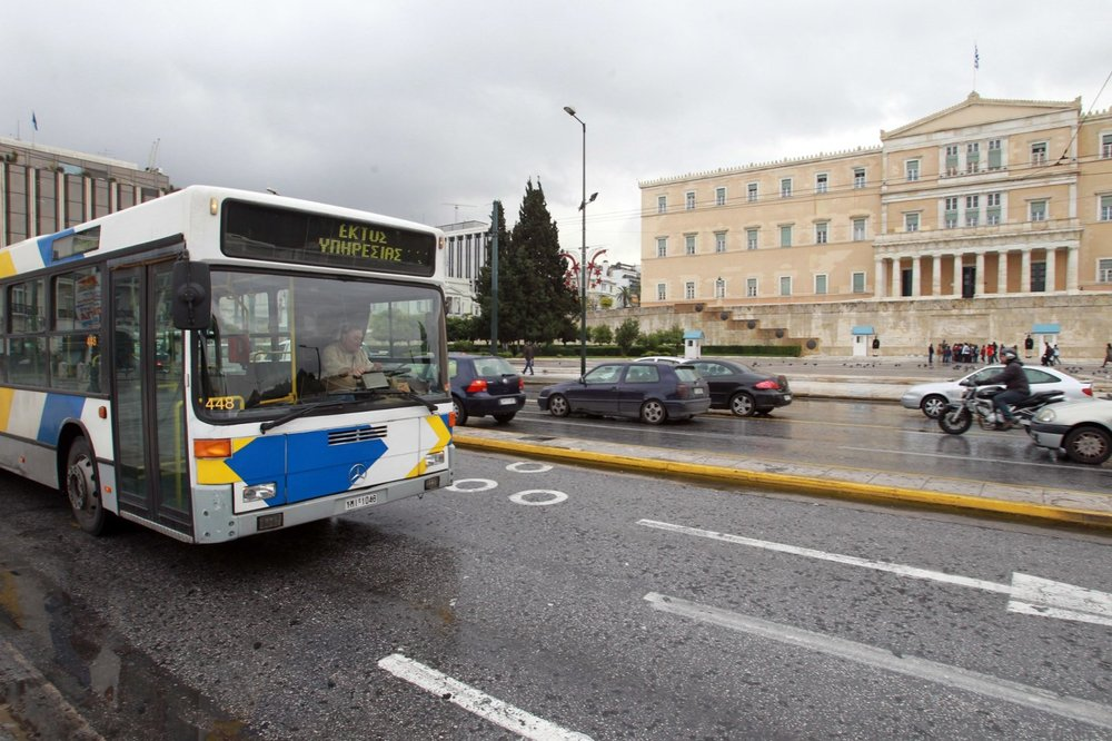 According to a new law in 2018, you can only enter the buses from the front door. Here, a bus passing in front of the Greek parliament.