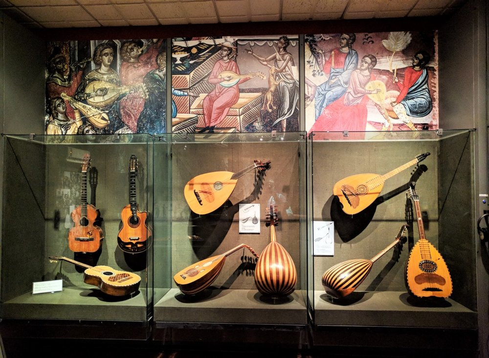 Inside the museum of Greek Folk Musical Instruments, you can find a wide variety of instruments, like bouzoukia and ouds. Source: Truevoyagers