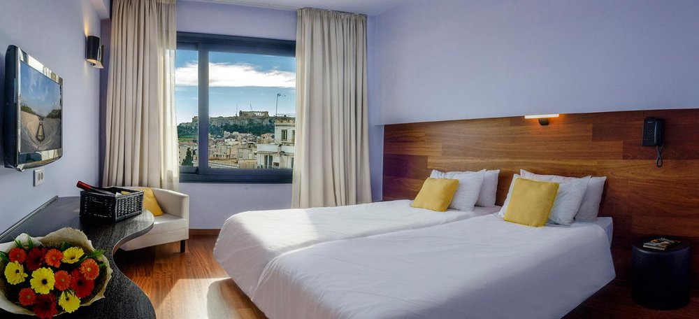 Athens Center Square: A modern and budget-friendly hotel featuring a rooftop terrace with panoramic views.