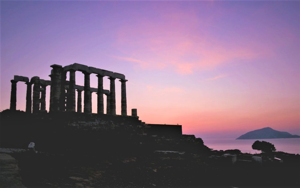 Enjoy a spectacular view of the Aegean during sunset time while at the Temple of Poseidon in Sounio. Source: Truevoyagers
