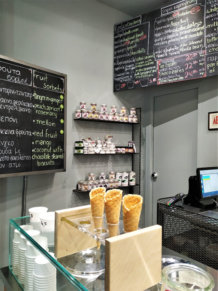 Inside Kokkion gelateria in Psyrri. A variety of flavors is written at the black-board.