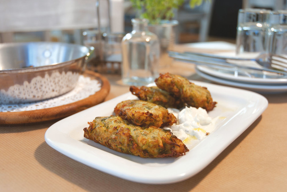 Crispy  kolokythokeftedes , served with home-made  tzatziki  sauce.