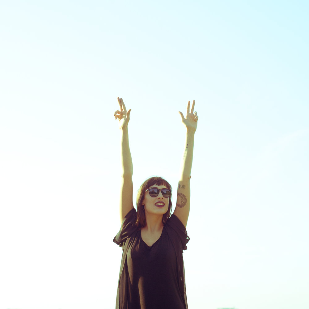 happy-young-woman-with-hands-up-482159730_2011x2011.jpeg