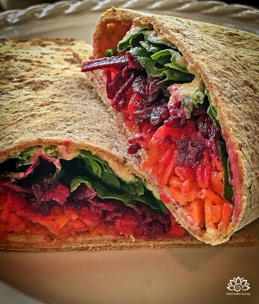 Vegetarian sandwiches do not have to be tasteless or boring! I pre shredded beets and carrots for the week. This wrap was loaded with love including beets, carrots, spinach, hummus, lemon juice and sunflower seeds.