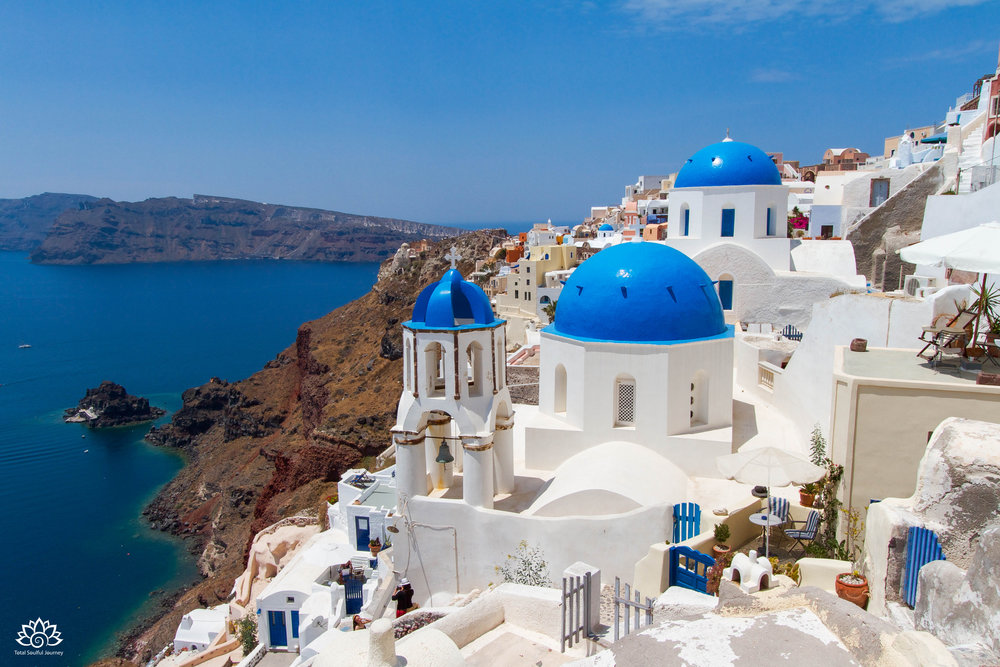 The town of Oia hugs the steep walls of the VOLCANIC caldera that makes up the amazing island of Santorini. Photo by Paul Garrett