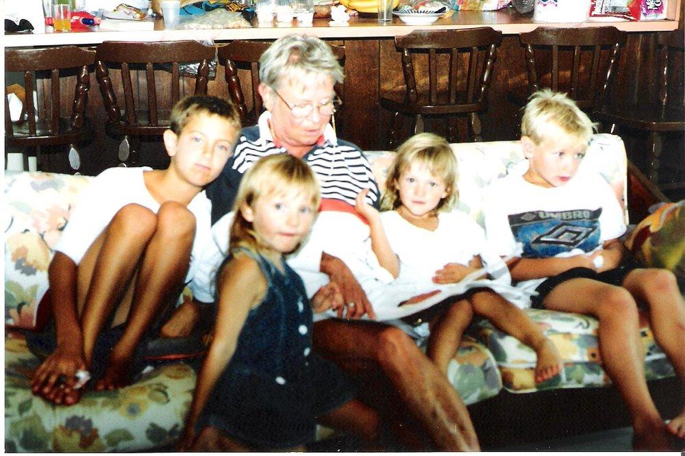 Grandma reading to the kids