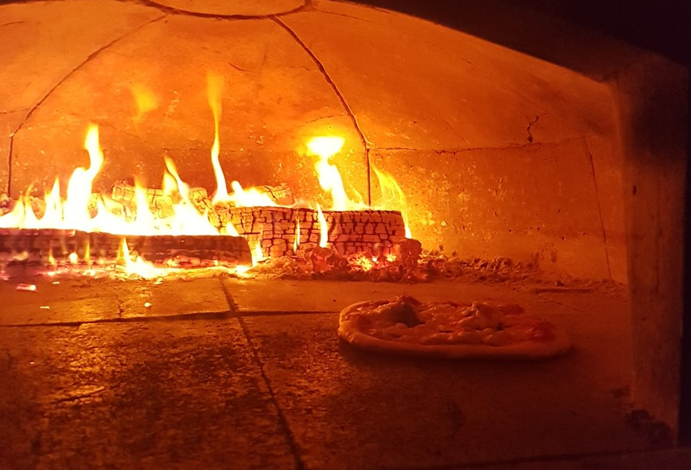 Mobile wood fired catering. - We will cater all manner of events from family gatherings, weddings, sporting events… We arrive an hour before the event is scheduled. Our dinning service is one and a half hours. We embrace a buffet style service allowing guests to sample a wide array of pizza pies. Our staff will continually replenish the buffet until everyone is totally satisfied. We are more than happy to work with you to create a menu that will be perfect for your unique event.