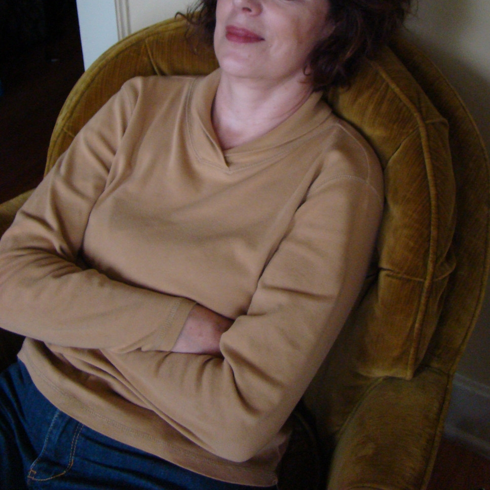 My mom wearing the camel-colored shirt after helping me move into my first big girl apartment, 2009.