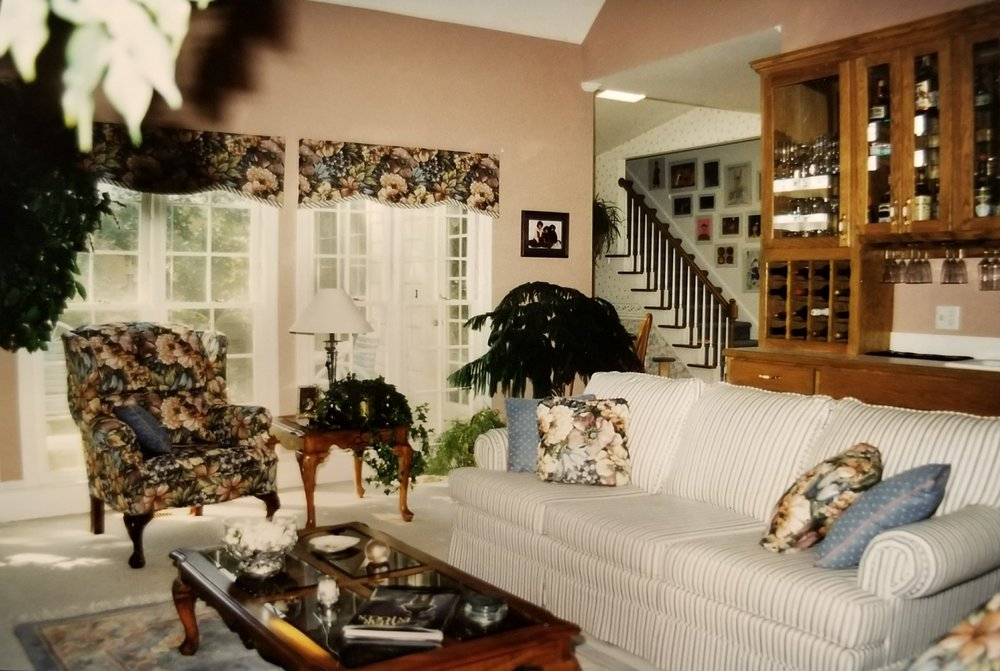 Bonus: an entire chair AND drapes in floral tapestry upholstery.