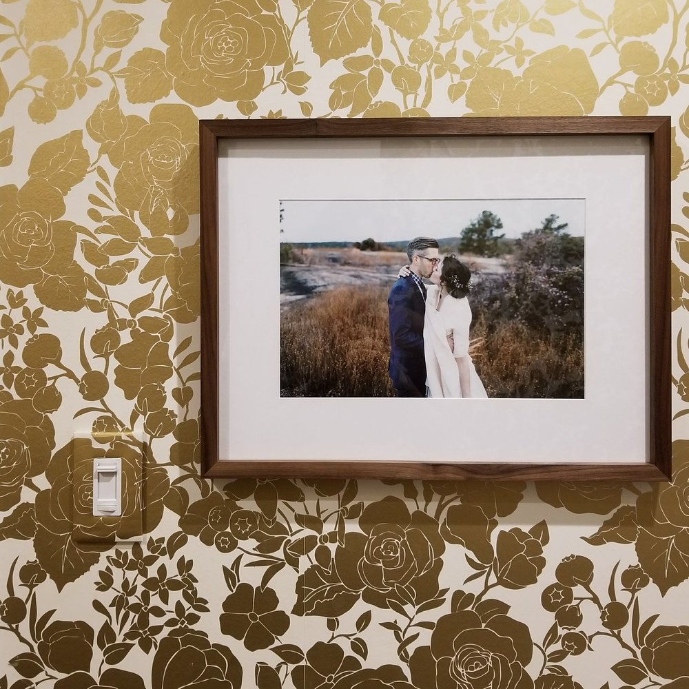 My favorite part of this isn't even the wedding photo, its the wallpaper-wrapped camouflaged light switch.