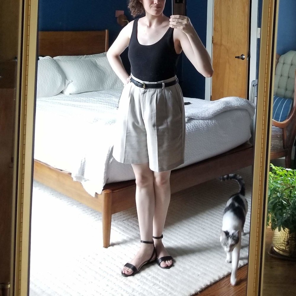 Monday - June 11, 2018This look seems like it's become an unofficial summer uniform for me! Black top tucked into beige shorts. I'm OK with that. I like the polished look that the belt gives. It's so easy for summer looks to get sloppy.