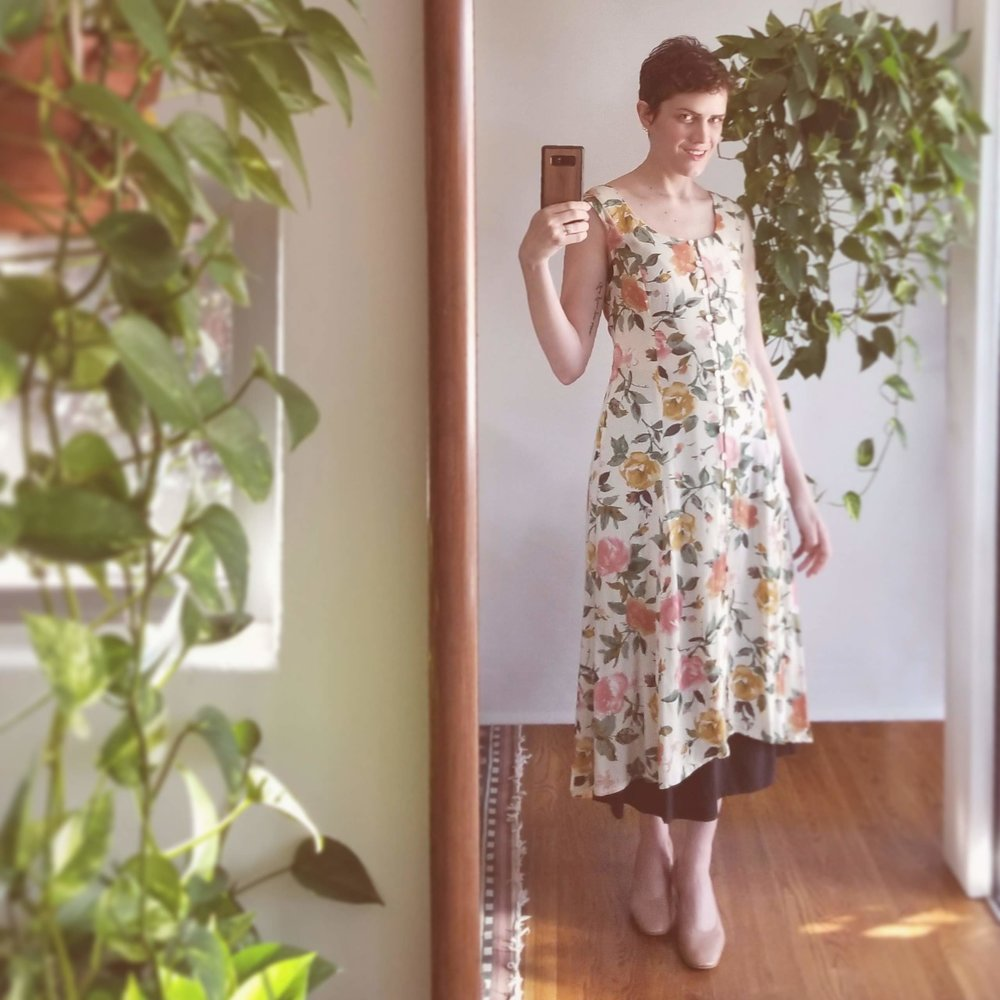 Vintage floral dress+ Elizabeth Suzann bel skirt + Everlane day heels - Speaking of that bel skirt… I discovered in the spring how WELL it layers under other skirts and dresses (May 25, 2018). Who'd have thought? How's this for a little edge — literally! I love how just a little crescent of black silk is peeking out from underneath the high-low hem of the vintage floral dress, taking it from so-summer to a-little-bit-autumn just like that.