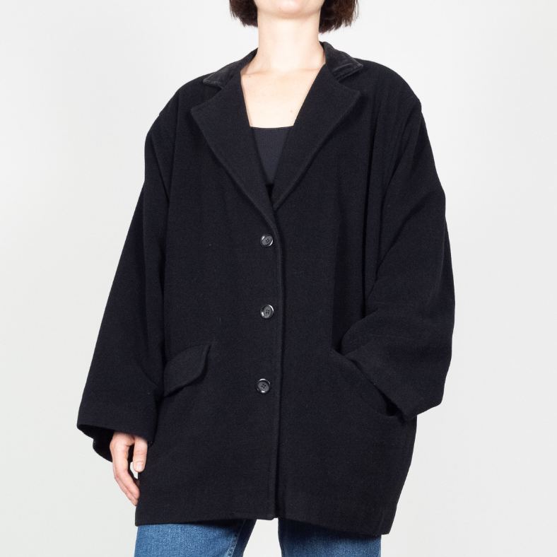 Black cocoon coat - $60.90 / Fabric content N/A but possibly 100% wool / Ships from CanadaIf you're into classic black, this one's for you. The pockets are still top-entry — boo. But it's got other things going for it, like, oh I don't know - VELVET TRIMMED LAPELS? Ooh la la.
