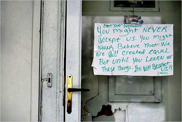 Residents of Lima, Ohio, posted a sign at the house where Ms. Wilson, 26, was killed and her 14-month-old son was injured.  Credit J. D. Pooley for The New York Times