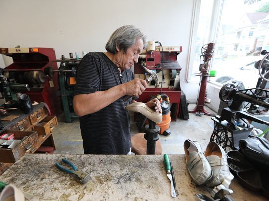 Reynaldo Acuna hammers a plastic tip onto the end of a high-heel shoe. Most of the shoes he repairs are workaday footwear, but customers occasionally trust him with designer models by Ivanka Trump and Miu Miu. (Photo: Kevin R. Wexler/NorthJersey.com)