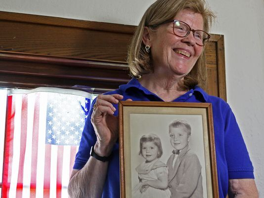 Anne Loving of Ridgewood holds a photo of herself and her older brother, Arnold LaGrange.  Photo: Chris Pedota/NorthJersey.com