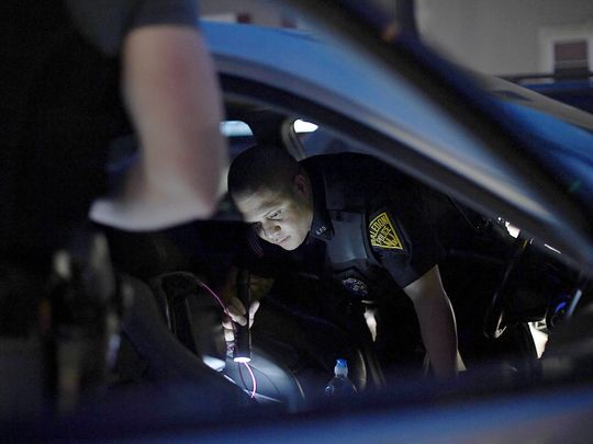 Haledon police officers search a car after detecting an odor of marijuana.  Photo: Danielle Parhizkaran/Northjersey.com