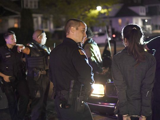 Haledon police officers question people under arrest for alleged possession of marijuana during a traffic stop.  Photo: Danielle Parhizkaran/Northjersey.com