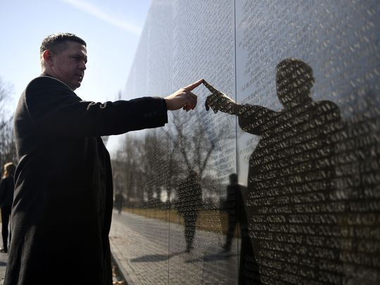 As a child, Michael Ryan would run his finger over Billy Ryan's name, etched into the Vietnam Veterans Memorial, because it was the closest connection he had to his father.  Photo: Danielle Parhizkaran/Northjersey.com