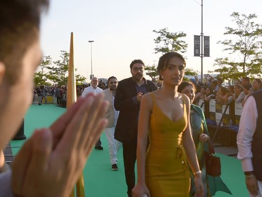 India's biggest film stars -- whose fame and fan bases far eclipse those of their Hollywood colleagues -- entered MetLife Stadium along a serpentine green carpet, Bollywood's answer to the red model used by the Oscars..  Photo: Viorel Florescu/NorthJersey.com