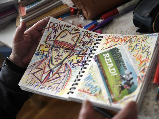 Kommit captures his flight-of-fancy thoughts and spur-of-the-moment inspirations in notebooks.  Photo: Danielle Parhizkaran/Northjersey.com