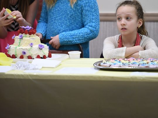 Summer Orner, 8, sits behind her creations as she waits for judging to begin.  Photo: Michael Karas/Northjersey.com