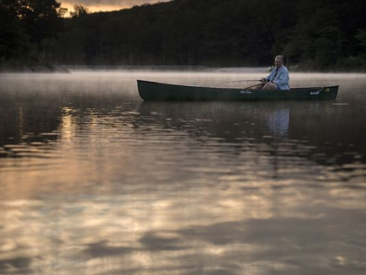 Joan LaDuke fishes on Lake Gerard at sunrise.  Photo: Mike Karas/Northjersey.com