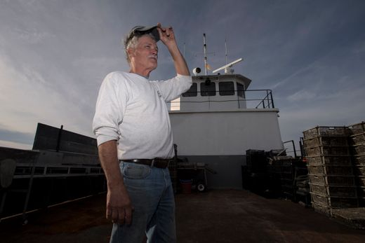 Steve Fleetwood on the boat he uses to deposit aquacultured oysters on the bottomlands of Delaware Bay.  Photo: Mike Karas/Northjersey.com