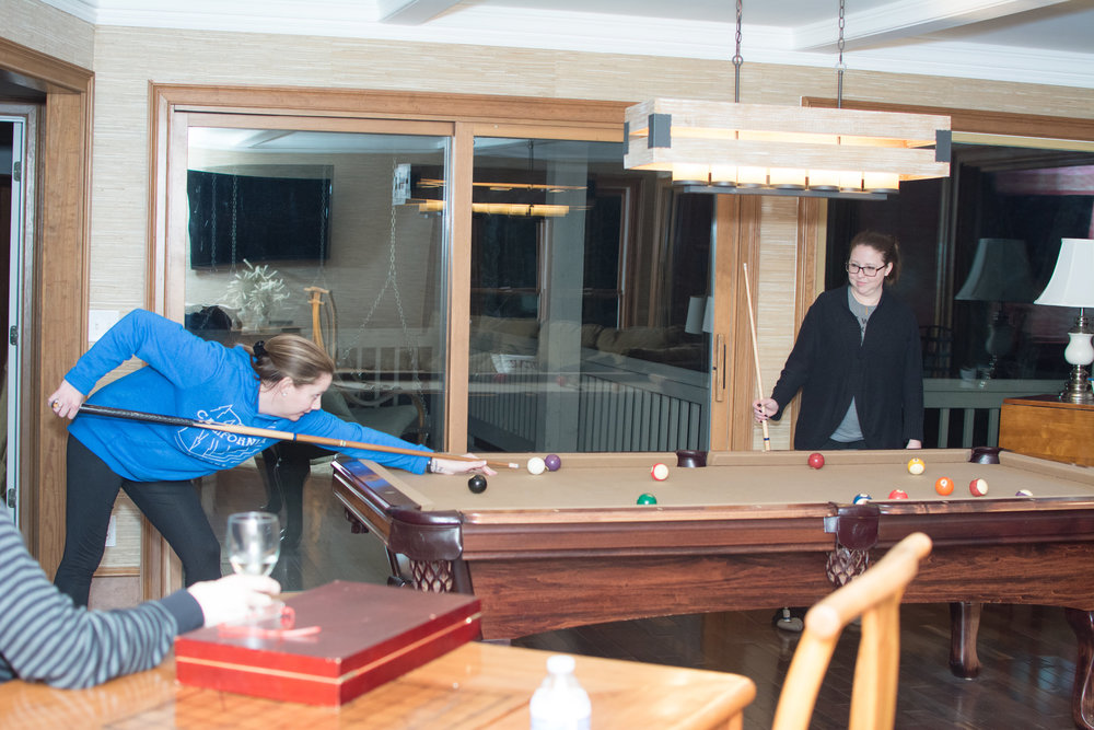 Game room includes a pool table and dartboard