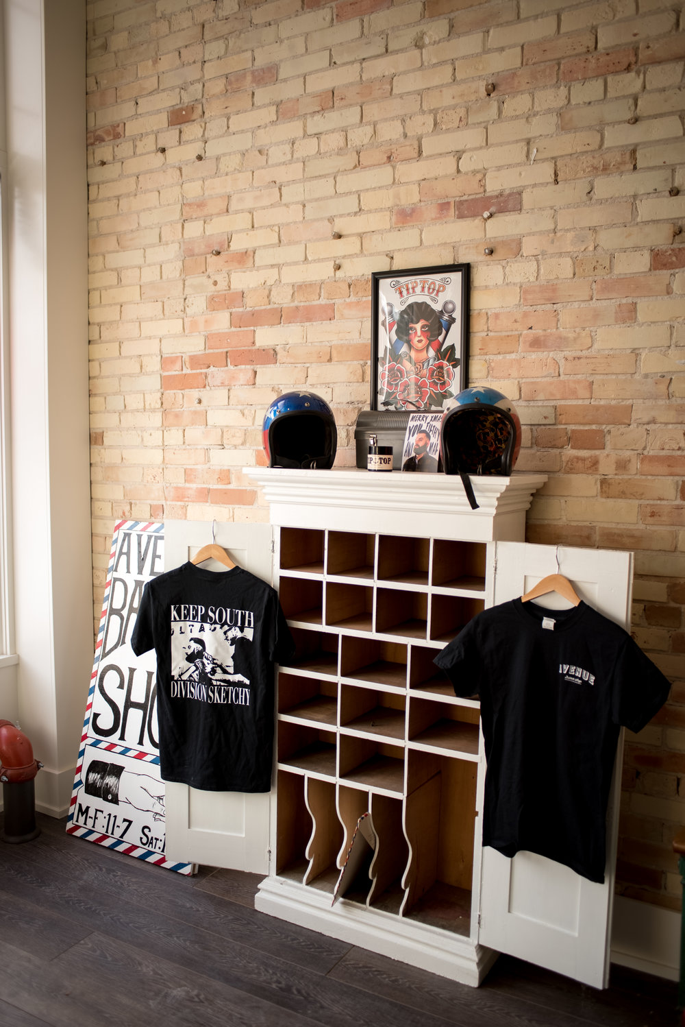 We carry Tip Top Pomade and our super rad t-shirts were printed by  DJ.  You can order one here.