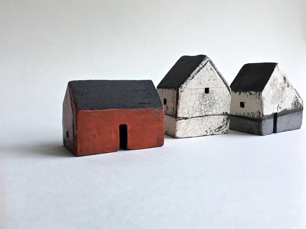 Small black clay houses, 5-6cm height £45 each