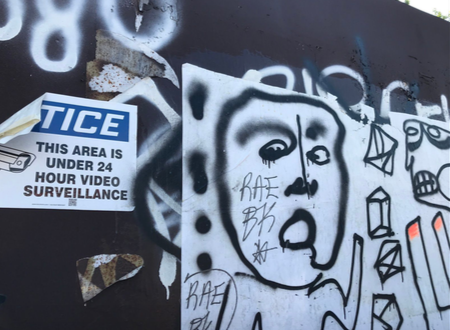 Conlon's work displayed right next to a surveillance sign- a clear sign of rebellion yet also a huge risk