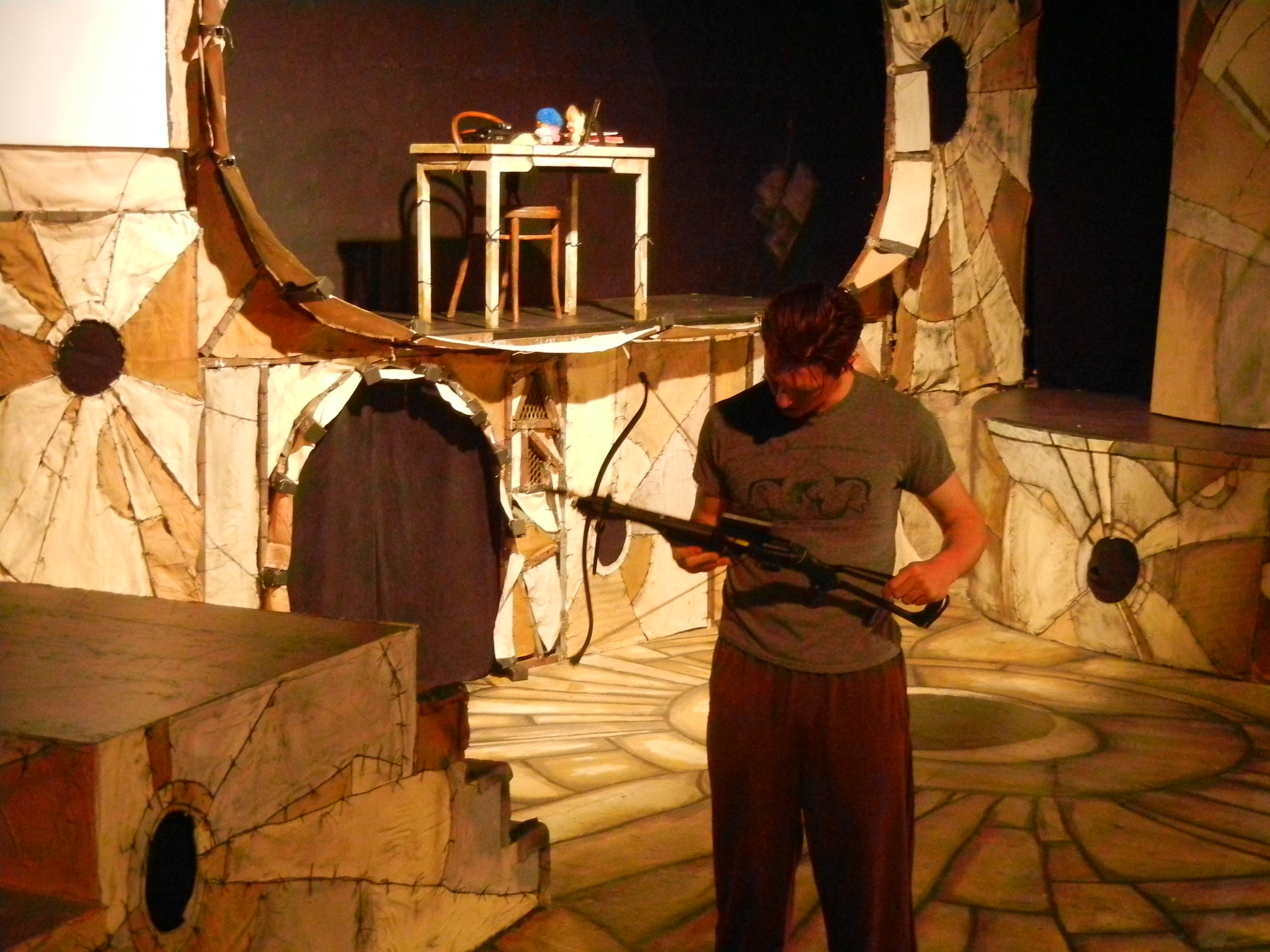 Jonathan Kells Phillips as Marquis de Carabas checks his crossbow prop.