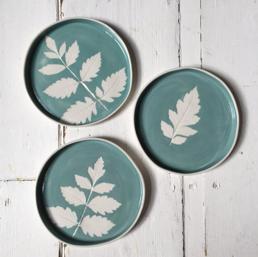 Teal Leaf Dishes  Made using real leaves and coloured slips, each piece is unique. 14 cm diameter.