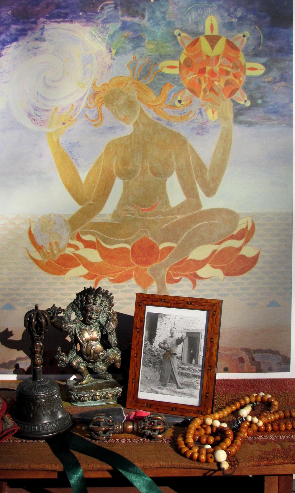 Seonaidh Yeshe Tungpa's practice supports: bell, meteorite phurba, dorje, mala,Vajrapani, Trungpa Rinpoche photo, 4-armed deity painting.