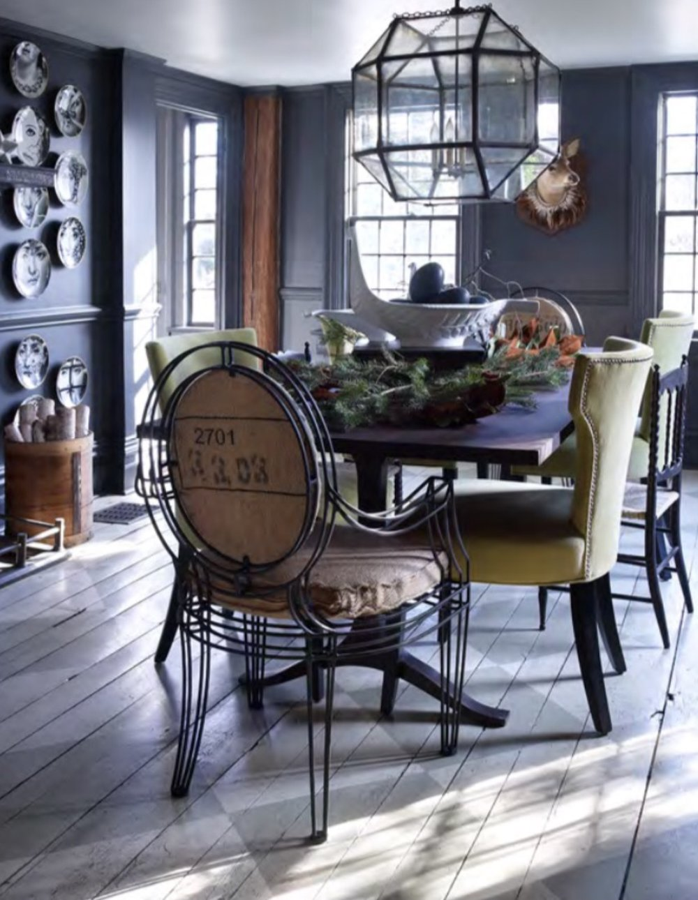 You see that we didn't touch the floors. They have aged so very well! We used  Wrought Iron  by Benjamin Moore on the walls and all wood work to allow all of the details to stand out. The chandelier is by  Restoration Hardware . Photo by  Ellen McDermott .