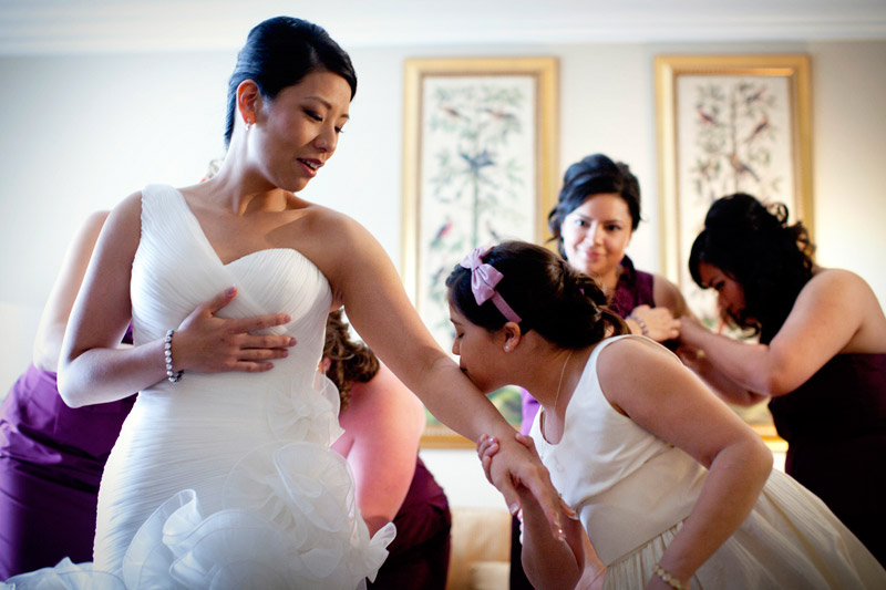 Bride getting ready in La Sposa wedding gown at Ritz Carlton in Half Moon Bay, California.