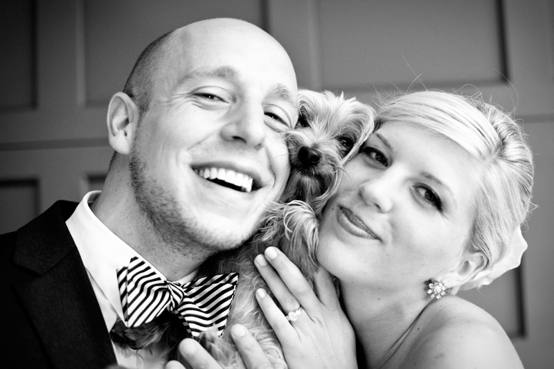 Adam and Ashley include their dog, Hudson, in a wedding portrait outside their Russian Hill apartment in San Francisco.
