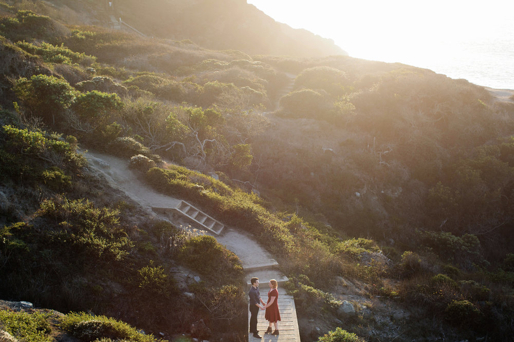 Alia and Chris on the hike down to Marshall's Beach in the Presidio during their engagement session.