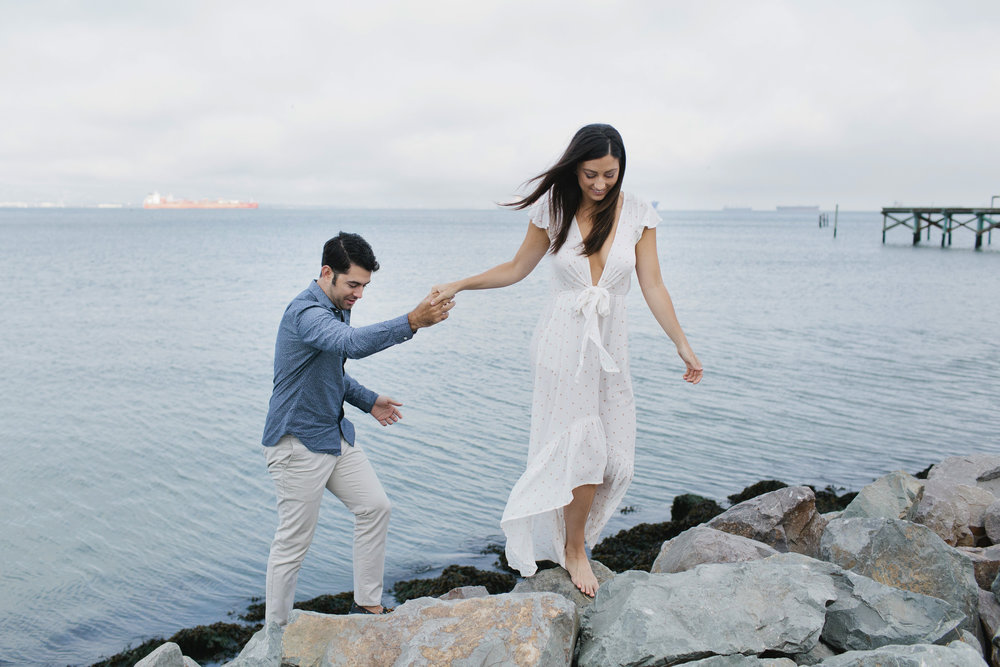 For their engagement session Brittany and Michael walk along the water in Mission Bay where they live.