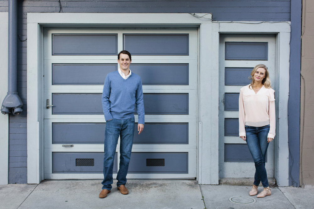 Kristen and Nick walk through their neighborhood in North Beach during their engagement session.