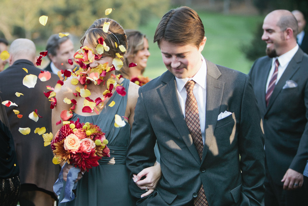 One of my all time favorite wedding moments: a bridesmaid getting flower bombed during the recessional.