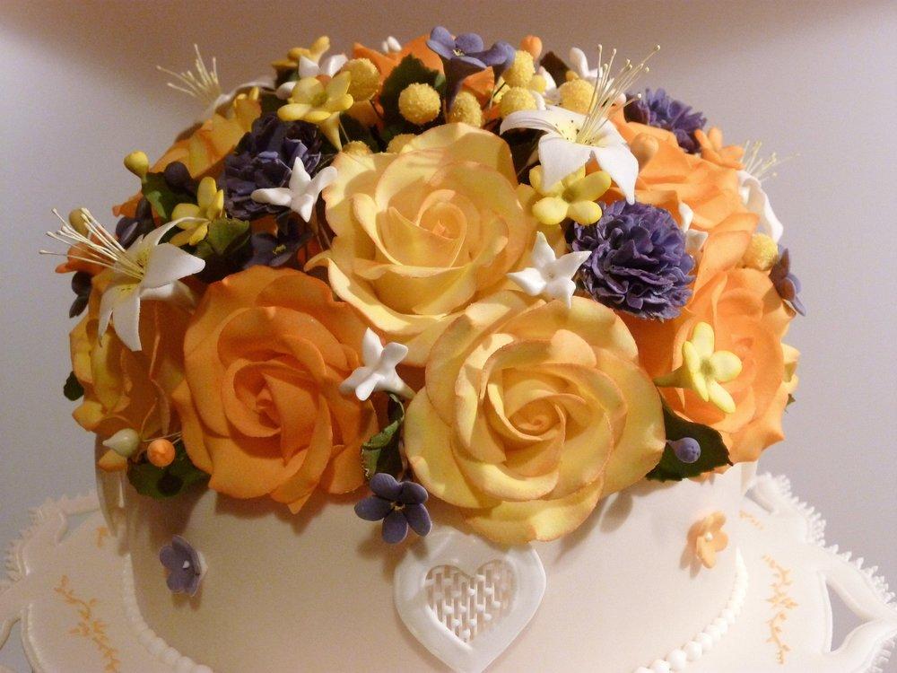 Sugar florals atop icing hearts