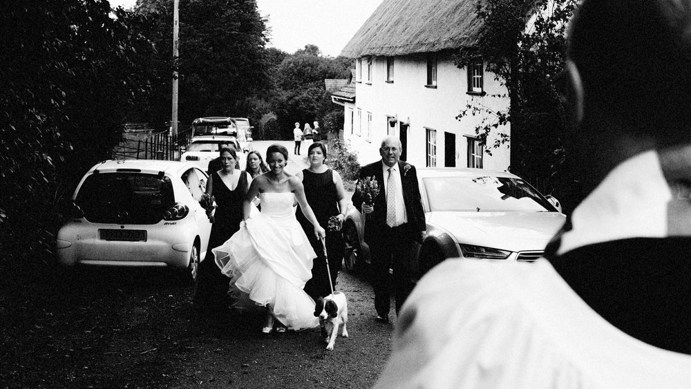 Helen and the gang walking to the church - rural wedding, Bourne, Cambridshire