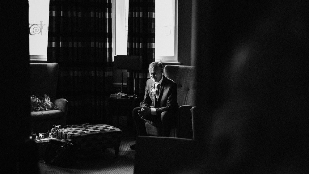 Father of bride waiting to see his daughter.  Picture taken at The Midland Hotel Wedding Venue, Manchester.